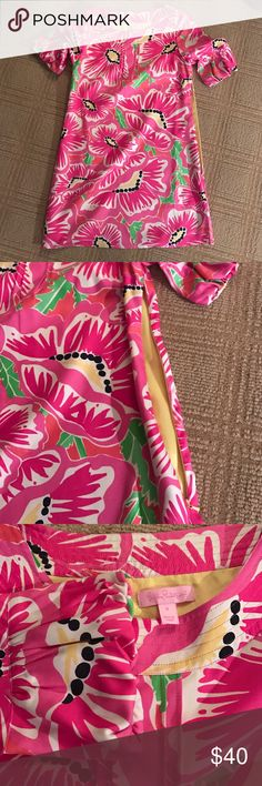 """Lilly Pulitzer Floral Dress Pink floral dress by Lilly Pulitzer. Gold shimmery stitching around the neckine all the way around, """"flower petal-like"""" sleeve ends- the sleeves are in the middle of short / long sleeve but not quite 3/4 length- a brilliant unique twist! Worn well, in good condition. Lilly Pulitzer Dresses Mini"""