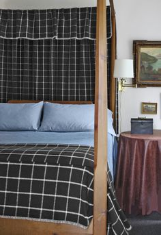 This New Jersey bedroom has a denim bedcover mixed with the patterned blanket and canopy.