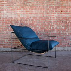 The ultimate lounge chair with an industrial steel frame and 100% down cushion. Fabric is customizable upon request. Dimensions  36L x 36D x 30H