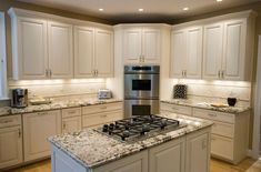 The wall oven in the corner is great for easy access. Good way to separate the oven from the cooktop. #WallOvens
