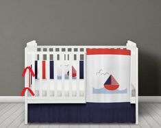 Baby boys nautical quilt with little sailing boat on the front. Red, navy and white nautical sailing boat bumper and quilt. Nautical Baby Bedding, Nautical Quilt, Baby Boy Bedding, Nursery Bedding, Nautical Theme, Girl Nursery, Bedding Sets, Boat Bed, Cot Bumper