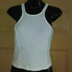 "BRANDY MELVILLE KNIT TOP-SIZE S-NWOT -Brandy Melville Knit Top -Size Small -New, Never Worn -Really Cute -57% Cotton, 40% Viscose, 3% Elastane -Made in Italy -White in color -From top to bottom, of top, without stretching is 18"" in length Brandy Melville Tops Tank Tops"