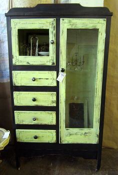 This vintage wardrobe makeover features two paint colors, stenciling in and out, and a glass door for the wardrobe. The piece was a mess when I found it.