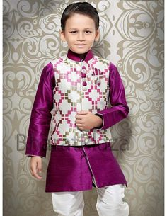 Your little son will look absolutely charming by wearing this purplish magenta color raw silk kurta. Fashionable in every sense, this regular-fit kurta comes with white color geometric print nehru jacket and white color pyjama. The jacket is designed with high neck collar, decorative brooch and trendy buttons for more attraction.