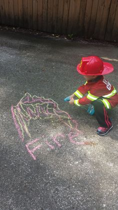 """So CUTE...Firefighter Role Play to put out """"Chalk Fires"""" by spraying them with water using a spray bottle to put out the """"Chalk Flames."""" I used this fun learning activity to help my son recognize more words that start with the letter F...words like Fire, Firefighter, Flames, Fire Truck. He was really engaged during the entire activity and enjoyed spraying the letter F, along with the fire. :)"""