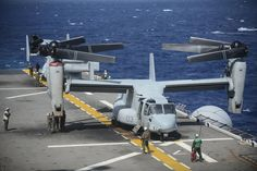 EAST CHINA SEA (Feb. 26, 2014) Sailors secure an MV-22 Osprey tiltrotor aircraft assigned to Marine Medium Tiltrotor Squadron (VMM) 265 on the flight deck of the amphibious assault ship USS Bonhomme Richard (LHD 6). Bonhomme Richard is the lead ship in the Bonhomme Richard Amphibious Ready Group currently conducting joint force operations in the 7th Fleet Area of Responsibility. (U.S. Navy photo by Mass Communication Specialist 3rd Class Christian Senyk/Released)
