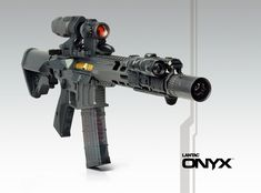ONYX Rifle shown with Aimpoint Micro H-2 and X3 Magnifier, LWRC Compact Stock, Lancer Systems Magazine, BMD, Surefire |Scoutlight, Magpul Rail Panels and MBUS Pro, Lantac Spada-ML Handguard...