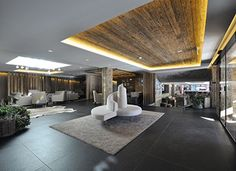 Award Winner Hotel In Rougemont - Project by Plusdesign, architects Claudia Sigismondi & Andrea Proto Interior Architecture, Interior Design, Hotels, Lounge, Das Hotel, Award Winner, Design Awards, Entrance, Press Release