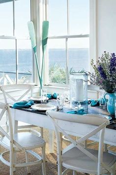 I absolutely LOVE this Coastal Inspired Dining Room! I can just feel the ocean breeze! #dining #beach #coastal #decor #home #getthelook