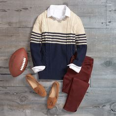 What to Wear: Fall Football Fashion  You can hang with the die-hards even if you're not in head-to-toe team apparel. Dress some of the part in a cable-knit sweater (in your team's colors, of course) paired with fall-toned denim.