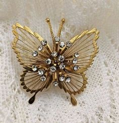 VINTAGE RHINESTONE BUTTERFLY PIN BROOCH OPEN WORK GOLD-TONE SIGNED MONET