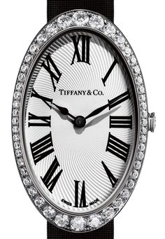 Our newest Tiffany cocktail watch in 18k white gold with a white guilloché dial and round brilliant diamonds on a black satin strap.