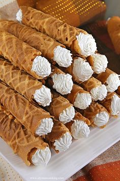 """Cream Filled Pizzelles Recipe (Trubochki) """"Trubochki"""" are rolled pastries. With a pizzelle maker you can make a batch of these cream filled pizzelles and serve them as finger food desserts. Finger Food Desserts, Cookie Desserts, Just Desserts, Cookie Recipes, Delicious Desserts, Dessert Recipes, Picnic Recipes, Pizelle Recipe, Cannoli Recipe"""