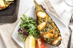 Stuffed aubergines with spinach rice and halloumi - the perfect vegetarian dinner to serve alongside a simple salad! Topped with crispy halloumi cheese.