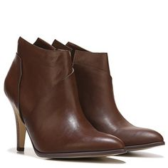 Look fashion forward in the Carlos by Carlos Santana Equinox Bootie.Faux leather upper in a dress bootie stylePointed toeInside zip closureOverlay detailsTextile lining with a cushioning footbedTraction outsole, 3 ¾ inch heel
