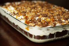 A SLICE OF HEAVEN CAKE! 1 package devil's food chocolate cake or german choc. cake mix 1 14oz can sweetened condensed milk 1 jar caramel topping 1 8oz tub cool whip 4-5 snickers bar (my preference) you can use skor, heathbar, or mini reeses.