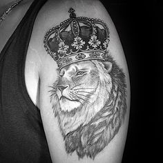 Upper Arm Male Lion With Crown Tattoo