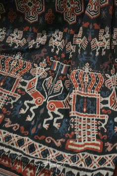 "Hinggi or men's wrap from Sumba in ""mahang"" pattern, a depiction of a climbing lion protecting the crown which clearly inspired by Dutch coat of arms. The use of Dutch traditional design on sumba textile signaling that the textile was meant to be worn by a highest class of nobleman or ""maramba"". Done in very neat and dense weaving with 4 color including red, blue and black made out of natural dyes. Original pattern was derived from Rende, but this textile made in Mauliru - Sumba."