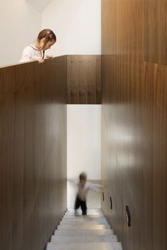 Beautiful concrete staircase with walnut clad walls. Haus B by Christine Remensperger.