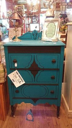 Sam's Revitalized Furniture & STUFF painted this dresser with Peacock and Midnight Sky with Best Dang Wax in Black on the accents.