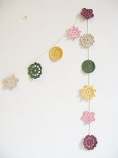 crochet + garland. great idea for all my mismatched granny squares.