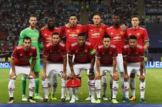 The Manchester United team pose for a photo prior to the UEFA Super Cup final between Real Madrid and Manchester United at the Philip II Arena on...