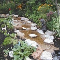You can build your own DIY creek with some concrete, gravel, PVC pipe, and a rec… – backyard landscaping diy Backyard Stream, Garden Stream, Backyard Water Feature, Ponds Backyard, Koi Ponds, Backyard Waterfalls, Garden Ponds, Backyard Patio, Outdoor Water Features