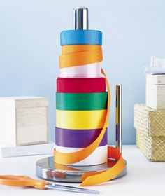 repurposed paper towel holder as ribbon organizer