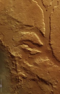 This scene shows a section of Ismeniae Fossae that straddles the southern highlands–northern lowlands of Mars. The 2 km-wide curvilinear trough that runs through this image contains numerous parallel grooves and ridges comprising material from the trough walls and material that has been dragged along the floor by ancient glaciers and ice-rich flows.