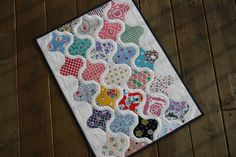 Ornament Mini Quilt - finished by twinfibers, via Flickr - love this quilt! Would be fun to do in a Christmas theme...