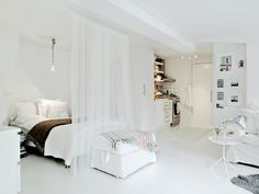 Hang just one rod from the ceiling and use a sheer panel to create separation. This would be a great look to do in all white and then have some pops of color (hot pink + gold accents?!)