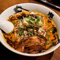 Saikoro. Nakano-ku, Nakano 2-28-8 (Near Nakano Station). Koitani started making his own noodles, thick and eggy. His soup is pork and chicken based, with whole smoked mackerel. He finishes the broth with a rich, dark shoyu and shingles the soup with thin slices of pork belly.