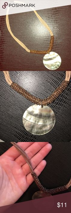 Brown authentic necklace••• Brown cloth material that attaches to dark brown beads and has a gray shining stone connected. About 12in in length. Feel free to ask about bundling! Happy Poshing :)  Jewelry Necklaces