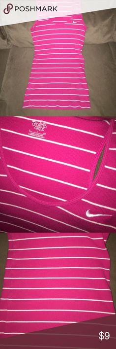 Nike Striped Ribbed Tank Size Small Super cute dark pink with white stripes. Would fit a XS or S has stretch to it :-). Lowest offer is the price listed. Bundle to save more. No trades or Mercari. Nike Tops Tank Tops