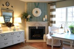 I LOVE the shutters over the fire place. Maybe I can do this on my empty living room wall with a mirror instead of a wreath? :)