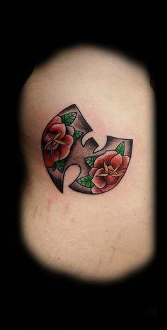 wu + roses tattoo