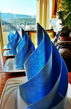 Adore the swirl or wave napkin folding