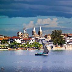 Photo by @jonathankingston Dhow sailing past Stone Town, Zanzibar – the historic capital of the spice trade, and a UNESCO World Heritage Site.  #Africa #Zanzibar #Tanzania #StoneTown #sailing #building #architecture #UNESCO @natgeocreative
