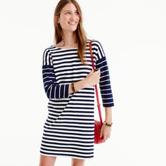 An easy-but-polished T-shirt dress in colorblock stripes and ponte knit fabric (a customer favorite, thanks to its thick, stretchy, flattering nature). Straight silhouette. Falls above knee, 36 from high point of shoulder (based on size small). This style runs large, so we recommend ordering one size smaller than your usual size. Cotton. Machine wash. Import.