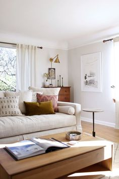 our sun-filled living room with warm woods and white   coco kelley