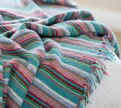 This striped spontaneity striped blanket pattern is simple but the colour work keeps it interesting with a charming tassled border. Shrug Knitting Pattern, Knit Shrug, Baby Patterns, Color Patterns, Knitting Patterns, Knitting Ideas, Yarn Projects, Knitting Projects, Square Blanket