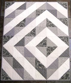 I love the calming, comforting use of color in this one. http://www.quiltingboard.com/attachments/pictures-f5/454450d1388695586-hst-grayandcream.jpg