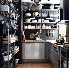 Love the use of Hollis shelves and grunt all wall storage to create a unified, industrial effect at a low price. Small, professional-style kitchen in stainless steel