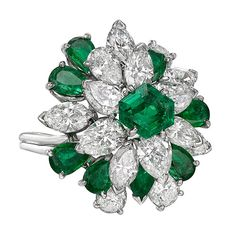 Oscar Heyman ​Emerald Diamond Cluster Ring | From a unique collection of vintage cluster rings at https://www.1stdibs.com/jewelry/rings/cluster-rings/