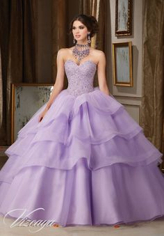 Tulle and Organza Quinceañera Dress with Tiered Skirt. Beaded Sweetheart Bodice. Corset Back. Bolero Jacket. Colors Available: Blush/Champagne, Light Purple, White