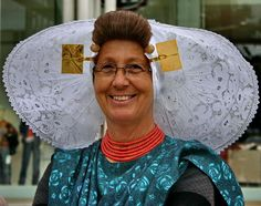 """Zeeuwse meisje""  A Dutch gal in South Beverland, in the province of Friesland, wearing a beautiful traditional head piece...typical to their region..."