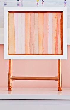Display your artwork on a copper stand that can be attached to a new or existing frame.