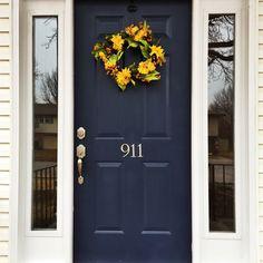 Navy blue front door yellow wreath