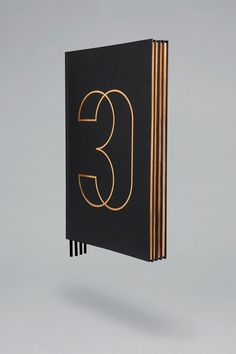Copper foiled brochure for Four Seasons private residence 30 Park Place by Mother