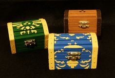 Left to right: Hyrulian symbol chest, Boss Key chest (Ocarina of Time), treasure/small key chest Unfinished wood chests Liquitex Heavy Body Acrylic paint Legend of Zelda © Nintendo Image © me 2013